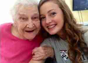 A senior citizen and her granddaughter