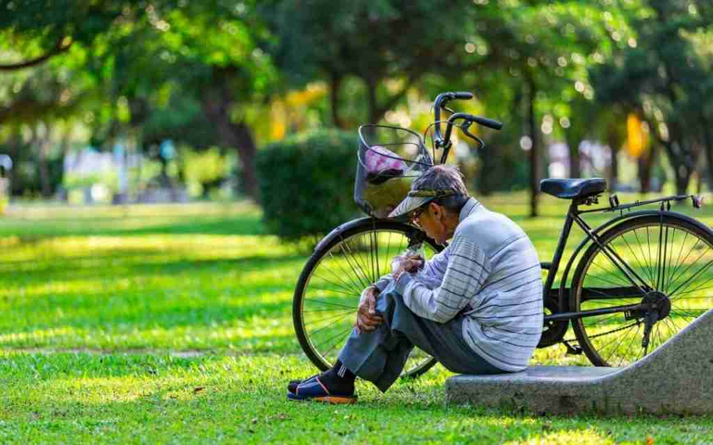 old person with bike